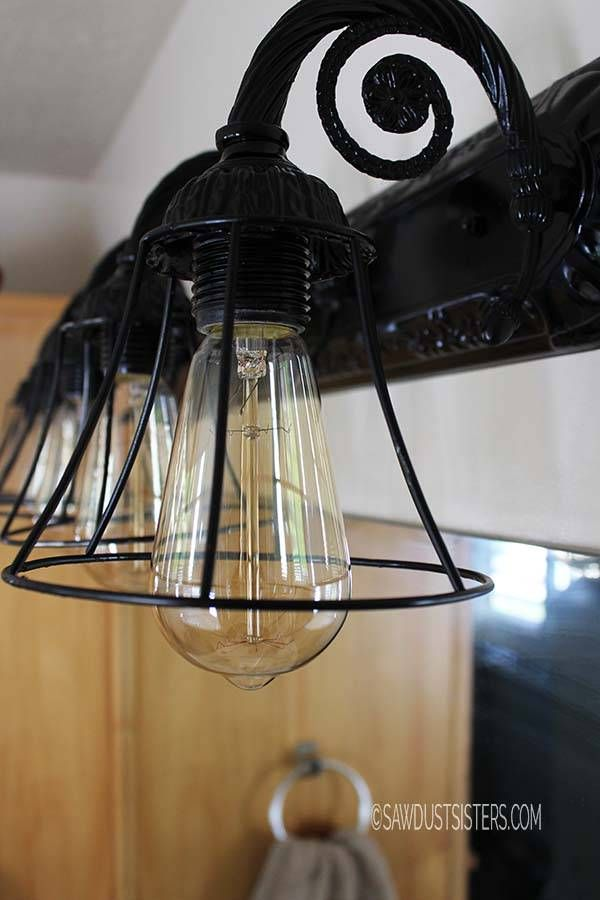 Bathroom Light Fixture Makeover - old glass shades to new up cycled metal cage light shades