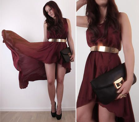 Metallic gold belt and a simple high-low hem dress with black oversize clutch. Accessories make all the difference here.