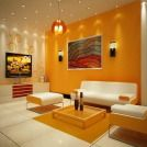 Living Room, The Elegant Design Of The Orange Living Room With The Wall Lights On Orange Wall Also The White Ceramic Floor And The Pendant Lamp Also The Glass Table ~