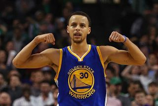 """What Does Steph Curry's Tattoo On His Bicep Mean?  Scroll to the end of this article for information about Stephen Curry's """"WOE"""" tattoo. If you recently watched a Golden State Warriors gameyou probably noticed the tattoo on Steph Curry's left inner-bicep. The ink appears to be a greater than symbol next to a less than symbol (> <). Curry has explained that the tattoo reminds him to live in the moment. Him and his wife Ayesha Curry have matching > < tattoos.  What Does Steph Curry's Tattoo On…"""