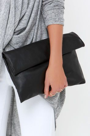"""As you make your way from party to after-party, you'll be glad you kept all your essentials in the Roller Coast to Coast Black Clutch! Soft and lightly crackled vegan leather forms a chic rectangular clutch that rolls up and secures with hidden magnetic closures. Unroll to find a front flap pocket, and main compartment (with hidden magnet closures) with fabric-lining and additional zip pocket. Carry as a clutch, or attach the shoulder strap measuring 53"""" at longest adjustment."""