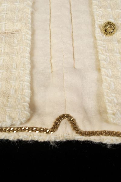 Gabrielle 'Coco' Chanel; French, 1960s; Detail of the lining from from yellow wool suit.