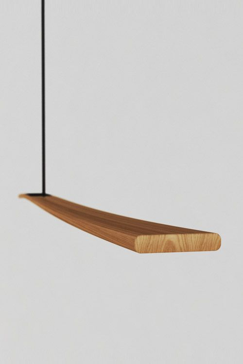 The balance pendant is a thin steam bent timber LED light ...