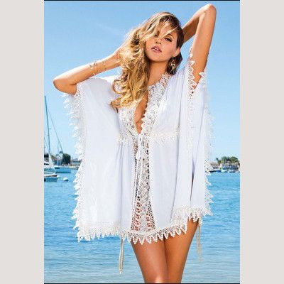 "Feel like royalty in this gorgeous crochet cover up by Sun Kitten Swimwear. The ""Heiress"" beach cover up is so luxurious it should be on every girls wish list this season! The crochet and lace details make this summer dress very feminine and flirty. Take this look from the sand to the streets with just a simple pair of nude wedge shoes, and you'll be ready to hit the shops in style."