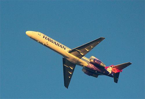 Hawaiian Airlines Boeing 717-200 take off from Honolulu International Airport.