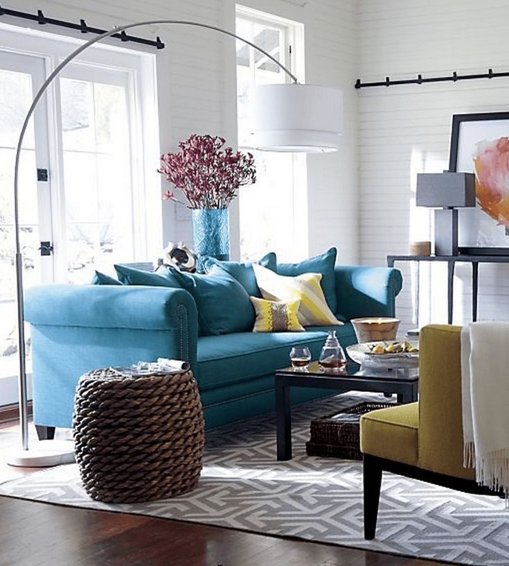 mustard and grey colour scheme with blue sofa  teal