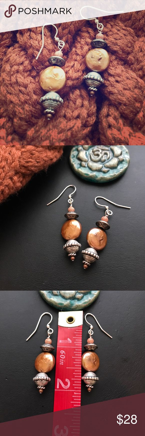 """•Harvest Moon Pumpkin Color Fall Pearl Earrings• Created & made by me using round """"sister coin pearls"""". Genuine Coin Pearl, Stardust Copper Beads at the top & Silver saucer beads adorned w/ Moons & Stars (shown in last pic so you can see detail. Finished w/ a shepards hook style ear wire. Around 2"""" Long, total length, matches perfect w/ Pumpkin Color Braided Knit Hat listed separately in my closet (pic 2) Upcycled/Moon/Stars/Fall/Pumpkin/Pearls Touched By The Sun Jewelry Earrings"""