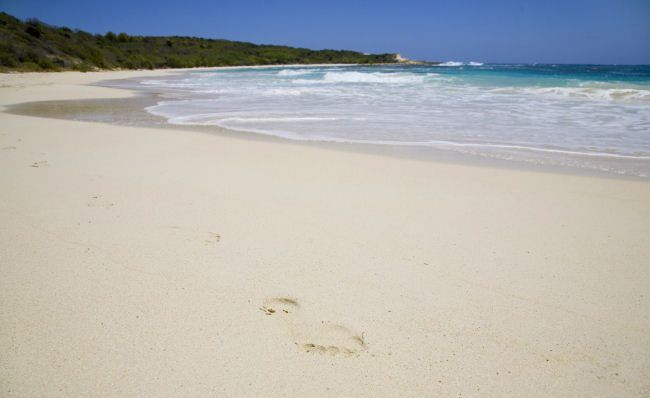 Six of the best....beaches in the Caribbean. The crescent moon stretch of Antigua's Half Moon Beach on the east coast makes it the perfect place to live out all those fantasies of being cast away together on a deserted island.