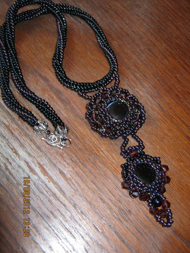 black necklace with purple pendant