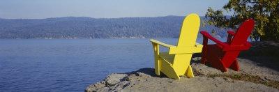 Red and Yellow Adirondack Chairs Near a Lake, Champlain Lake, Vermont, USA