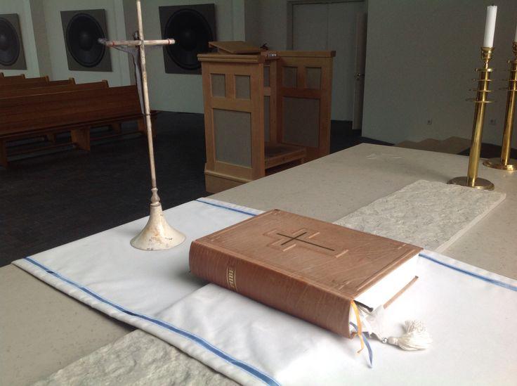 Viimsi Lutheran Church, Viimsi /Tallinn, Estonia. Altar.  Viimsi luterlik kirik, altar. Viimsin luterilainen kirkko, alttaripöytä, Raamattu ja krusifiksi.