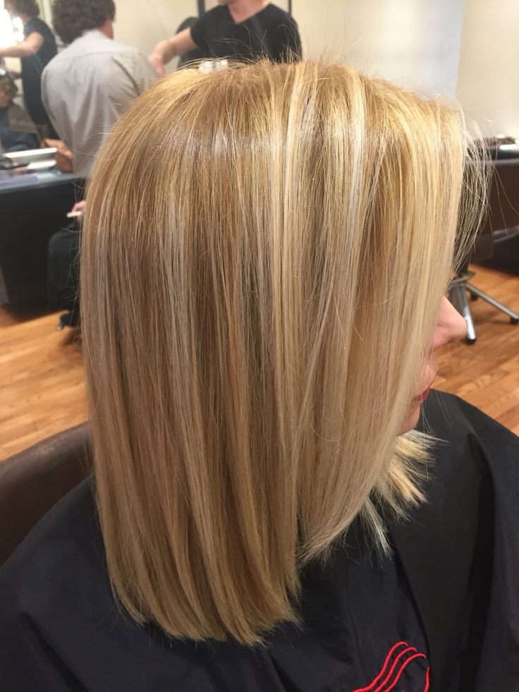 Highlift blonde with blonde highlights on lob haircut