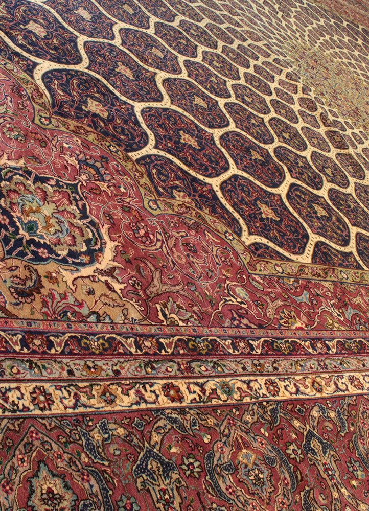 This is a silk and gold thread version of a Tabriz style rug. Tabriz, located to the north-west, is Iran's second oldest city and has been at the center of the rug-making world for hundreds, perhaps t