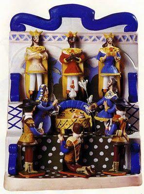 PRESÉPIO DE TRONO OU DE ALTAR – Presépio de Estremoz com figuras montadas em cantareira de barro, pintada à maneira tradicional das casas alentejanas. As figuras do presépio são em número de nove e encontram-se dispostas hierarquicamente em três degraus da cantareira, hierarquizadas de baixo para cima e da esquerda para a direita. Trabalho das Irmãs Flores (Colecção particular).