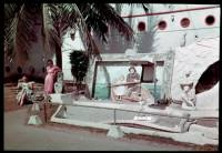 Charles W Cushman photo collection.  Look at the women lounging on the left side