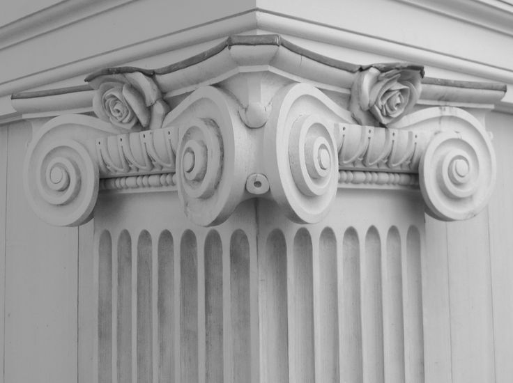Ionic pilaster capitals of the original have been adjusted to incorporate a rose decoration to reflect this folly's rose-filled setting.