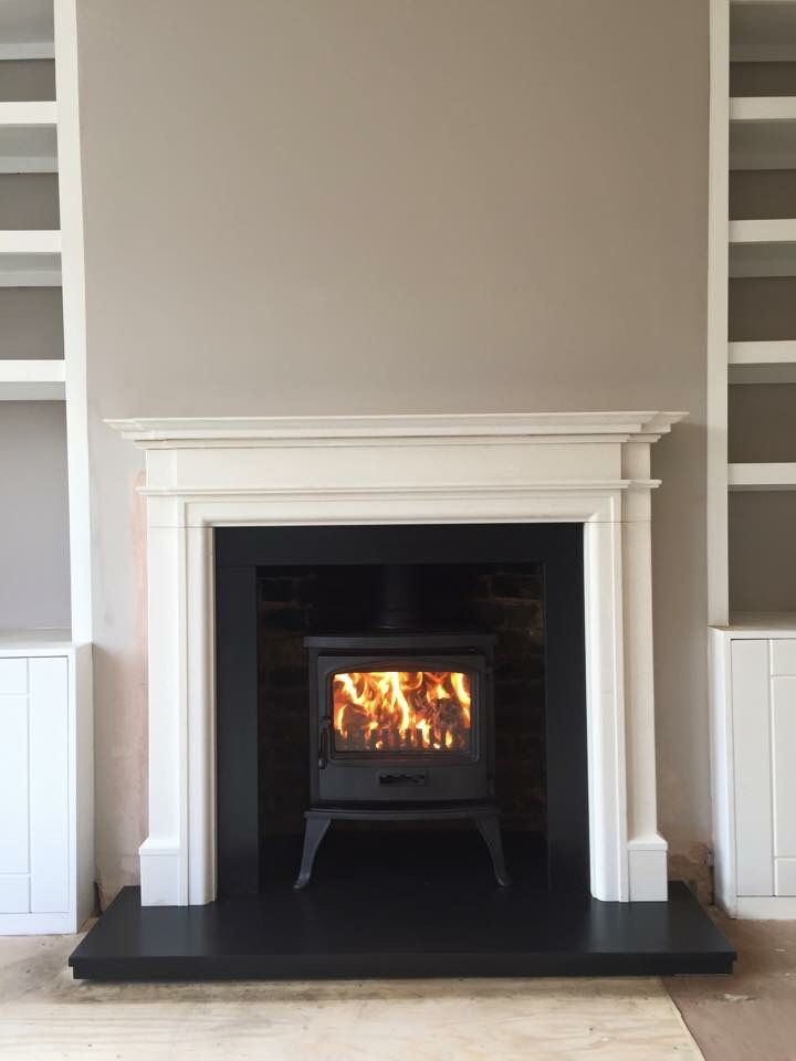 Capital fireplaces Sirius traditional multi fuel stove with limestone surround.