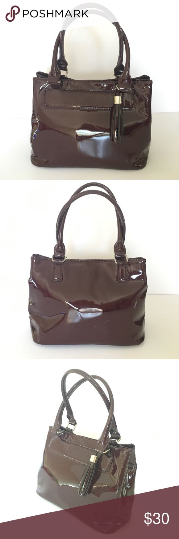 Marks & Spencer Collection burgundy glossy bag Marks & Spencer Collection burgundy glossy with tassel,  handbag in gently used condition Marks & Spencer Bags