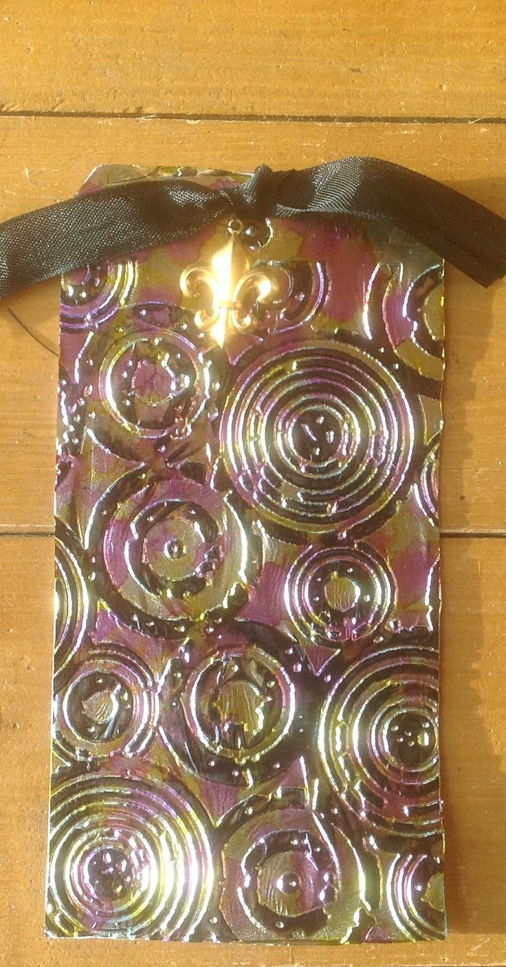 Tin foil, alcohol inks and embossed                                                                                                                                                     More