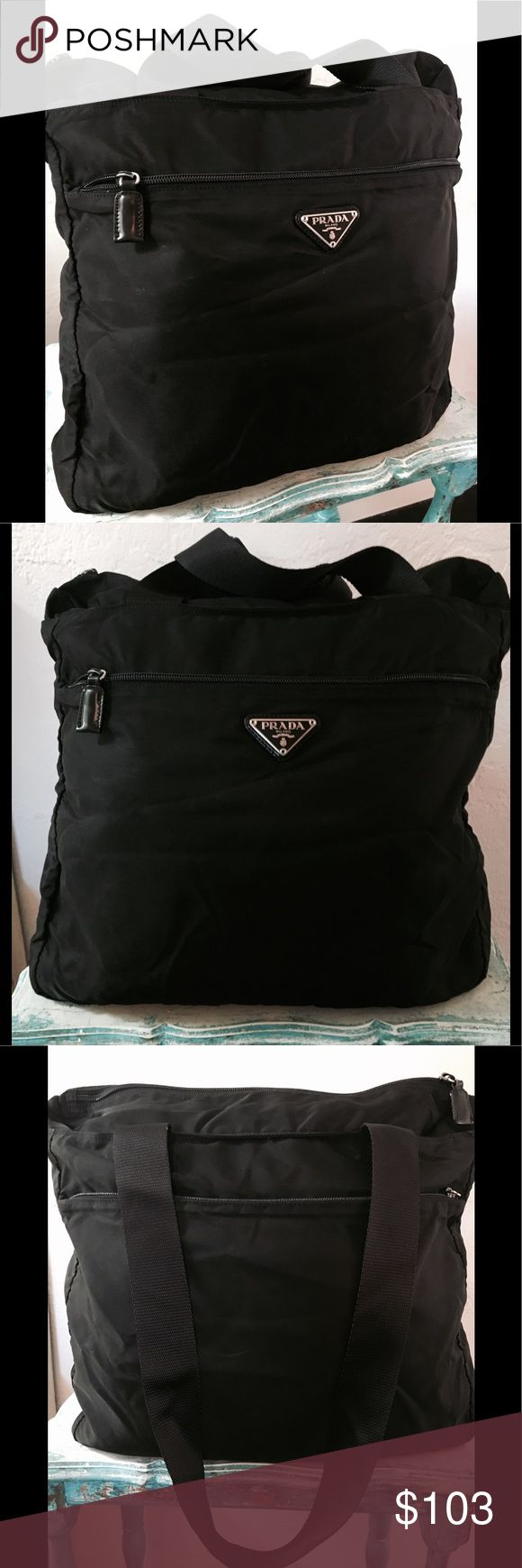 """AUTHENTIC PRADA NYLON BAG/laptop SHOULDER BLACK Pre owned, gently used and in good condition. •two zipper pockets outside on both sides•double canvas black straps•Top zip closure. Inside: 1 medium sz zip pocket. The following are issues to disclose: inside zipper pocket lining has pulled away from seam: approx 4"""". Easy fix to stitch•one of the 1"""" leather pulls has a rip on one side. It can be glued or replaced• one leather pull is off on one of zippers. Pics: empty & full. Inside full: 2…"""
