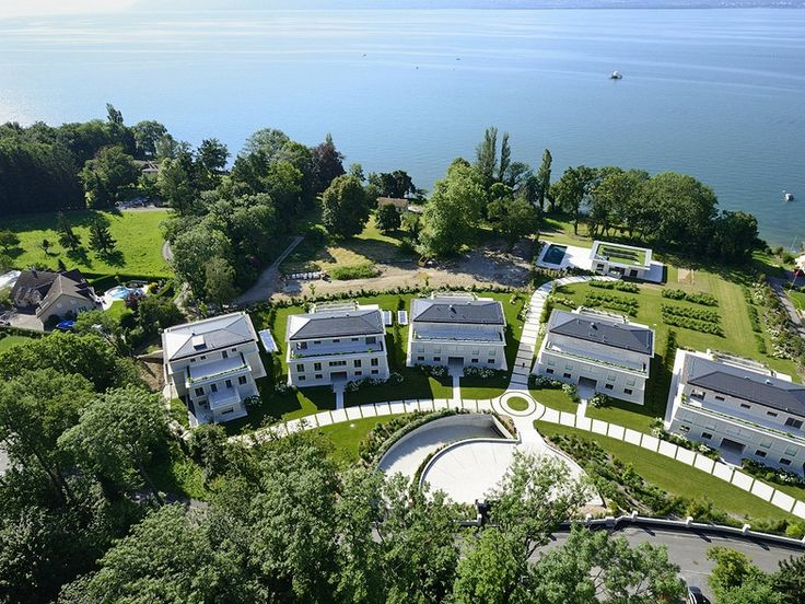 LA RÉSIDENCE DU LAC Luxury Lakefront Residence beside Lake Geneva  In a peaceful natural setting beside Lake Geneva, in the Vaud Canton of Switzerland, and looking across the Lake towards majestic Mont Blanc, La Résidence du Lac has been created for an exclusive clientele.  La Résidence du Lac nestles among noble trees amid splendid grounds covering 16,000 square metres and enjoys a high degree of security.