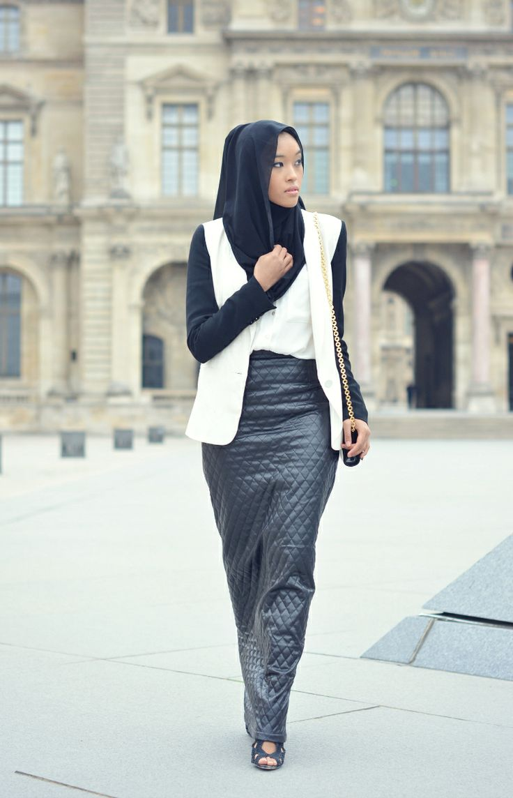 Team a black tube skirt up with a white shirt and blazer/waistcoat and black hijab for a chic, monochrome look.