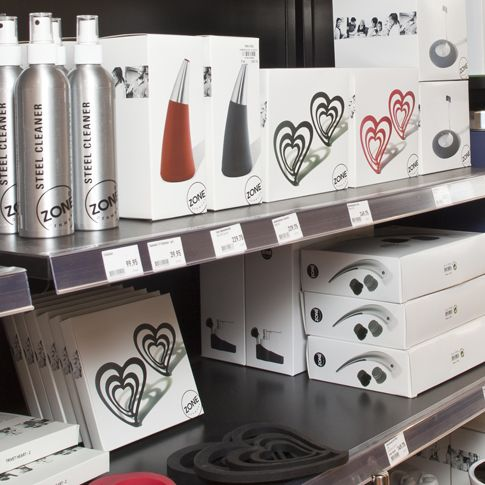 Modular packaging design and construction that ensures a calm and easy to merchandise brand facing at the shelf.
