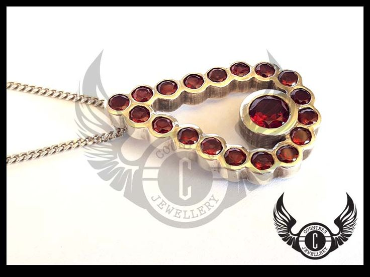 Tear drop pendant set with Garnets by Countess Jewellery