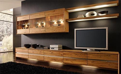 I love a nicely finnished wood with modern shape against a dark wall! ikea media center | ikea wall unit | Modern Wooden Entertainment Center ... | Dream House