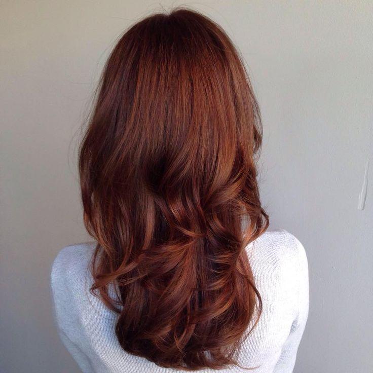 Long auburn hair with gentle layers