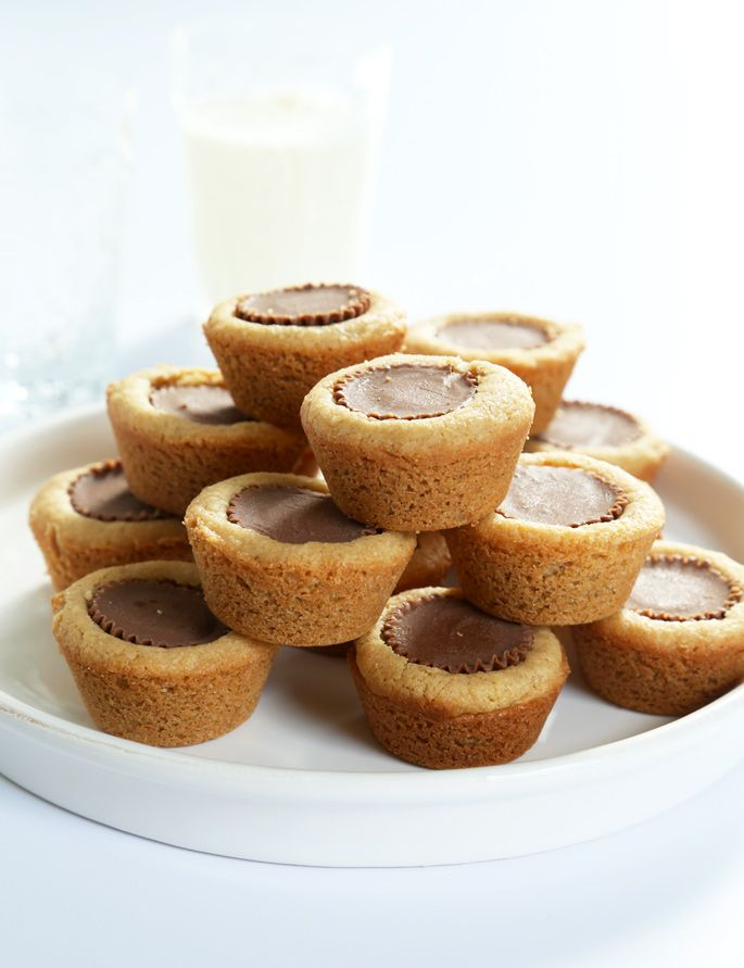 Classic Gluten Free Peanut Butter Cup Cookies. Soft, tender peanut butter cookies with a PB cup in the center!