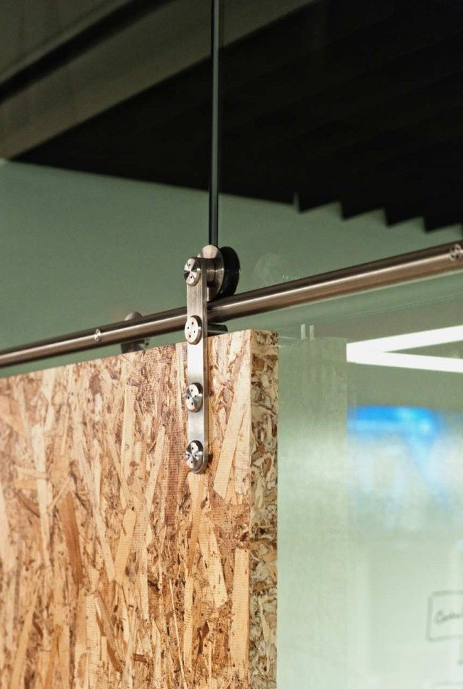 osb sliding door to frame in work space, laundry