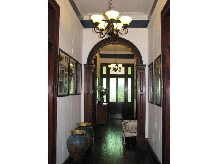 Hallway - red cedar archway (photo 2) Queenslander