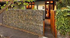 Cheap Fence Ideas   Gabion Stone Fences Simple Low Cost Stone Fencing. Maybe this with english moss growing on it that would one day eventually cover it.