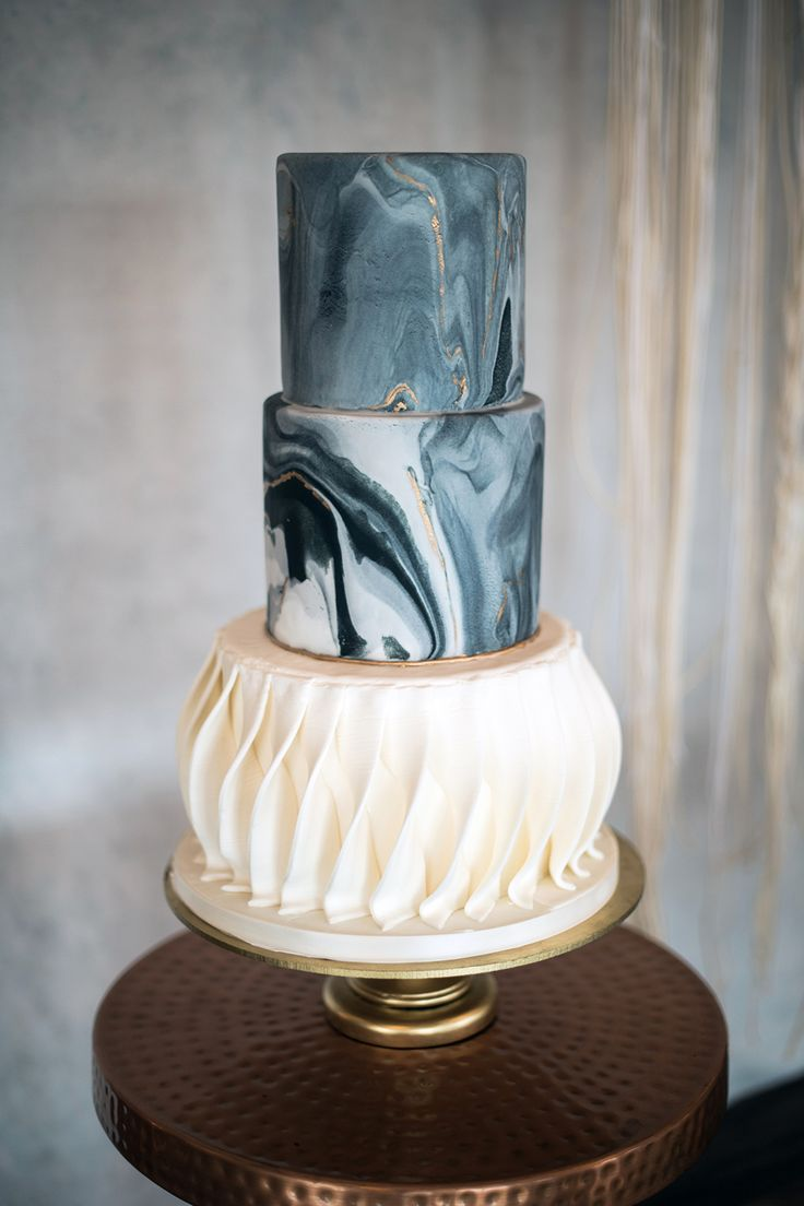 unique marbled wedding cakes - photo by Kristen Weaver Photography http://ruffledblog.com/modern-organic-wedding-inspiration-with-greenery