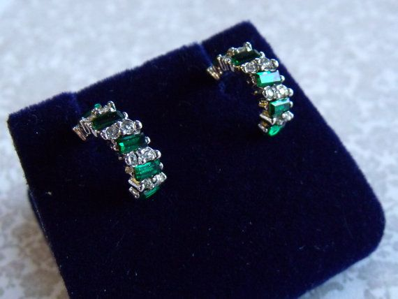 A lovely pair of costume vintage jewelry half hoop earrings for pierced ears in silvertone metal with faux emerald and white diamond stones.