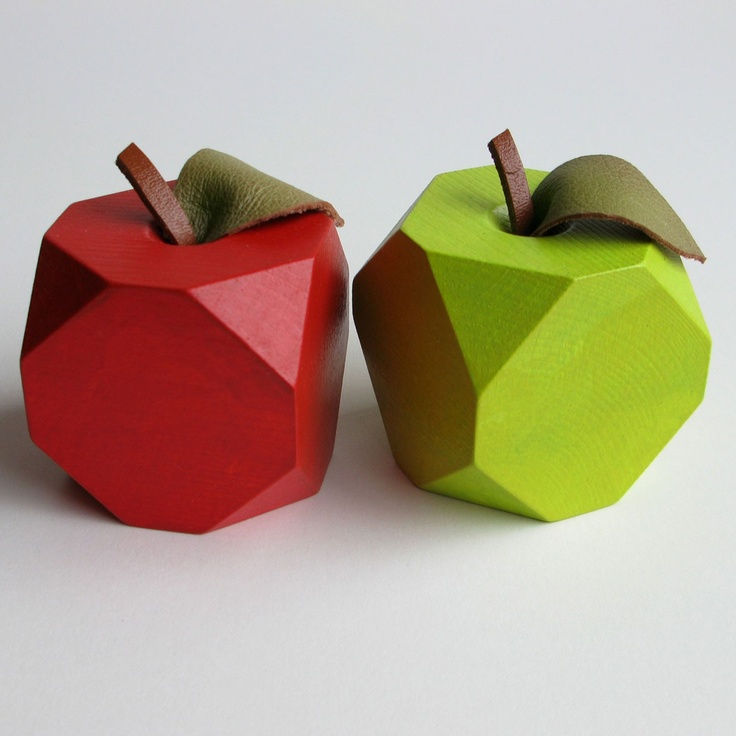 These lovely wooden apple ornaments, with reclaimed leather leaves, are a physical representation of a 'low resolution apple image'. They look great on their own, or amongst real apples in a fruit bowl. Made from FSC certified wood