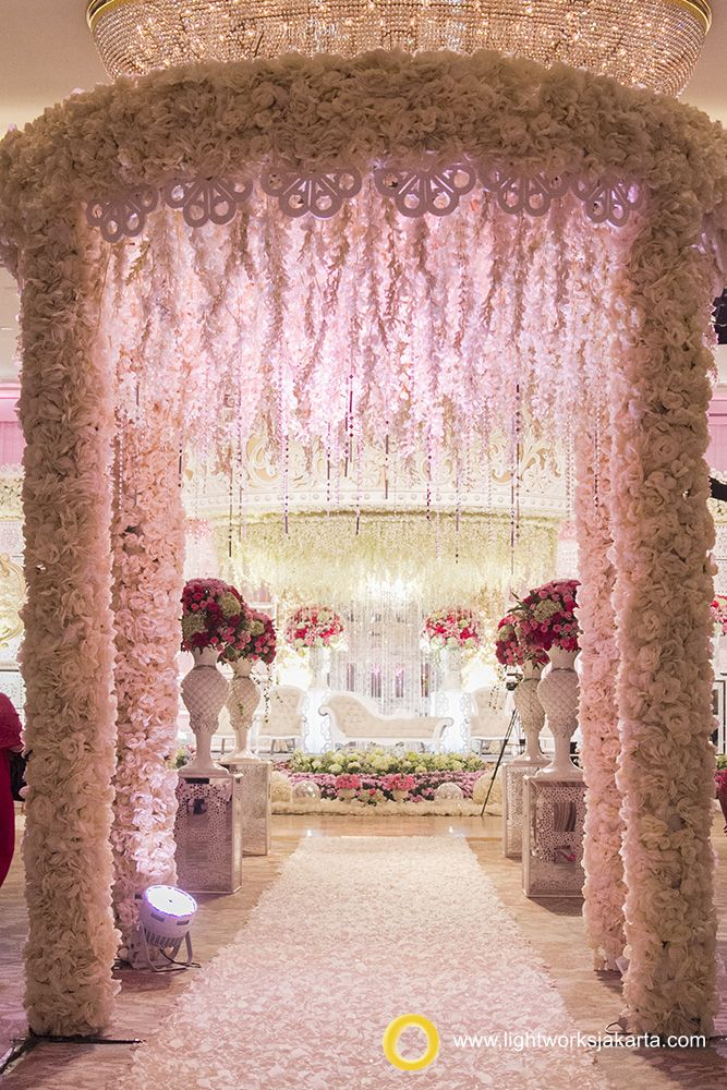 Flowery wedding gate for your wedding reception. Decorated by Grasida Decoration and lighting by Lightworks Decoration at Shangri-La Hotel Jakarta www.lightworksjakarta.com