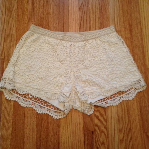 Flash SaleCream Lace Shorts Cute and sexy at the same time. Lace overlay and lined shorts. Elastic band for stretch. Worn once. No stains or snags! XS but would definitely for a Small. Pair with a cute crop top and be ready to go! Buy buy buy! They need a new loving closet to sleep in! ✨ Xhilaration Shorts