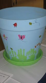 Bug finger & hand print flower pot - How cute would this be to give to mom as a housewarming gift when she moves here?  With a plant already in it or she won't put one in.