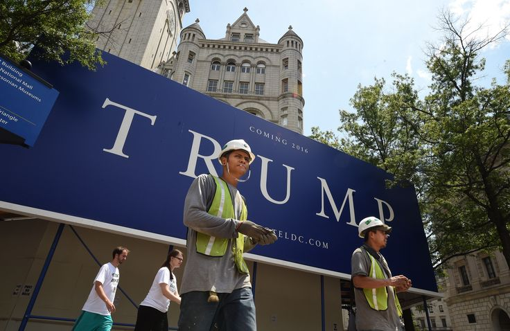 At Trump hotel site, immigrant workers wary