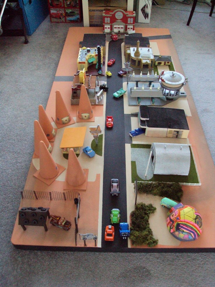 CARS - RADIATOR SPRINGS PLAY MODEL LAYOUT | created by Steve Harper over the week before Christmas 2009, it features the 4 standard 'CARS' playsets, and the Court House from the 'CARS' micro playset, together with home built models of the old town, Sally's Cozy-Cone Motel, Doc's, Sarge's Billet. Mater's yard and Fillmore's dome .... all made to suit the CARS models