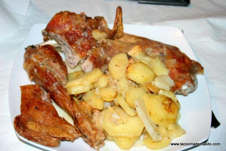 Cabrito asado con patatas vino y especias