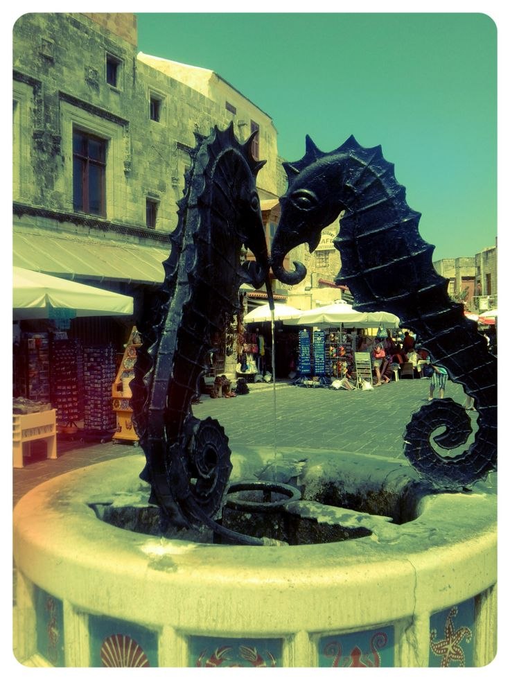 a fountain at the square of rhodes