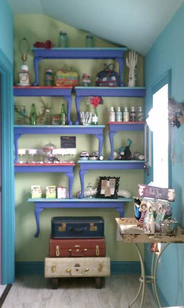 This could be a fun idea to expand on... Plus, I LOVE the color combination!     Polished Hands Salon in Taylorsville, NC; altered tables become display shelves for an odd shaped, narrow wall. From the Retail Details blog.