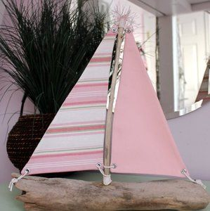Love these cute handcrafted driftwood boats