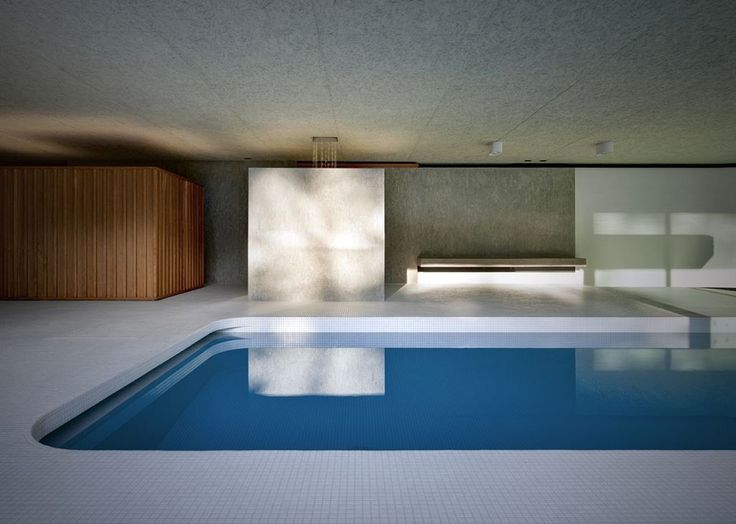 Architects Act_Romegialli extended a home in Northern Italy by adding an indoor pool in the form of a subterranean pavilion under t...