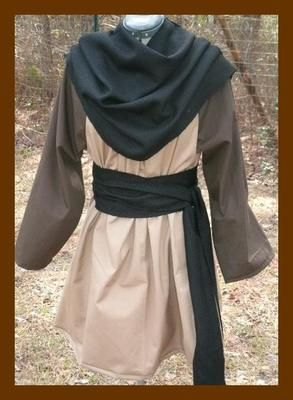 Renaissance Mens Tunic - LARP SCA L-XL Tan with Brown. A good rule of thumb for medieval tunics is to layer. Multiple layers give a costume more depth, no pun intended.