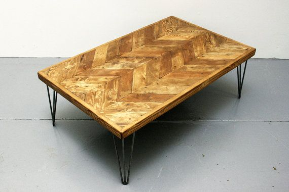 Reclaimed Pallet Wood Double Chevron Design Coffee Table with 3-Bar Hairpin Legs.  Approximate dimensions; Length 105cm (41 in) Width 65cm (25.5 in) Height 35cm (14 in)  Sanded multiple times to a smooth touch whilst retaining the natural character of the wood, with all edges gently rounded off. Finished with a light-mid tone rustic oak stain and three coats of clear satin varnish.  The steel hairpin legs are finished with a coat of clear wax and buffed.  Made to order.  /\/\  This is a…
