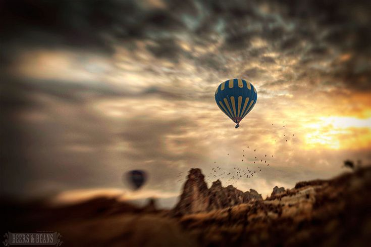 Cappadocia is famous for its hot air balloon rides over a beautiful landscape of rock spires and vineyards.